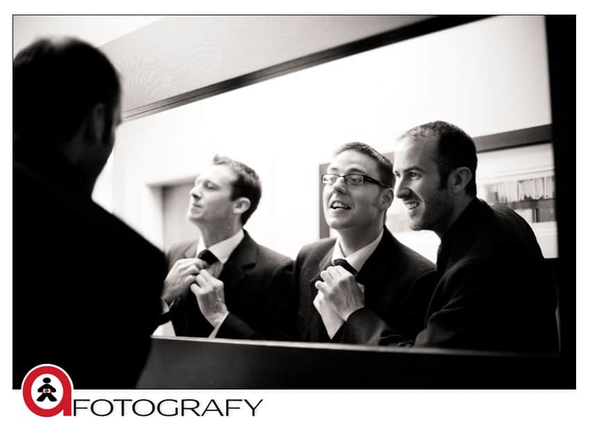 Groom-and-best-man-getting-ready-photos