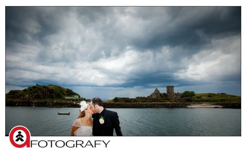 Wedding-couple-on-maid-of-forth-with-inchcolm-island-view