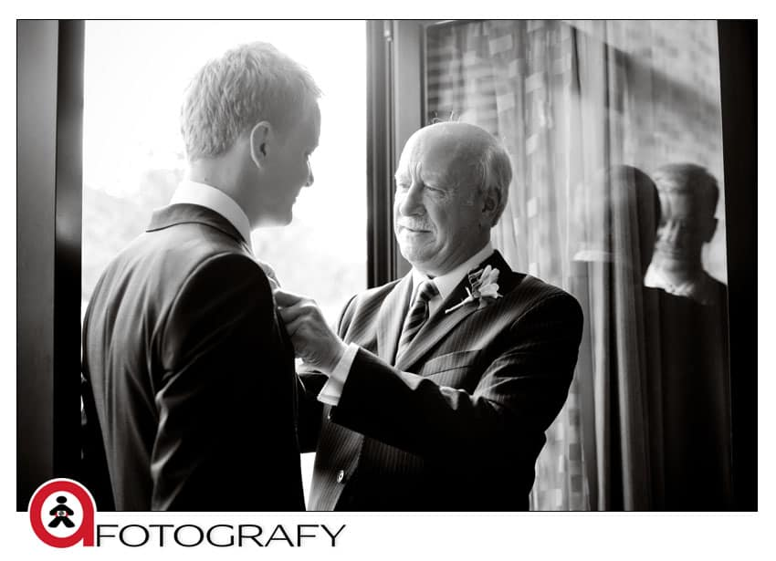 Groom-and-dad-getting-ready-in-the-hotel