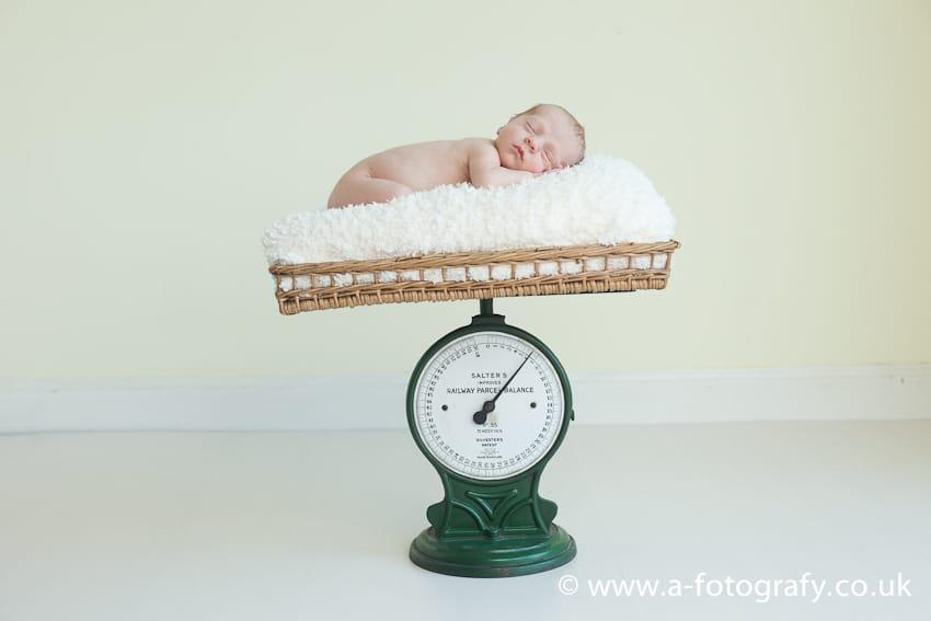 Newborn photography on scales