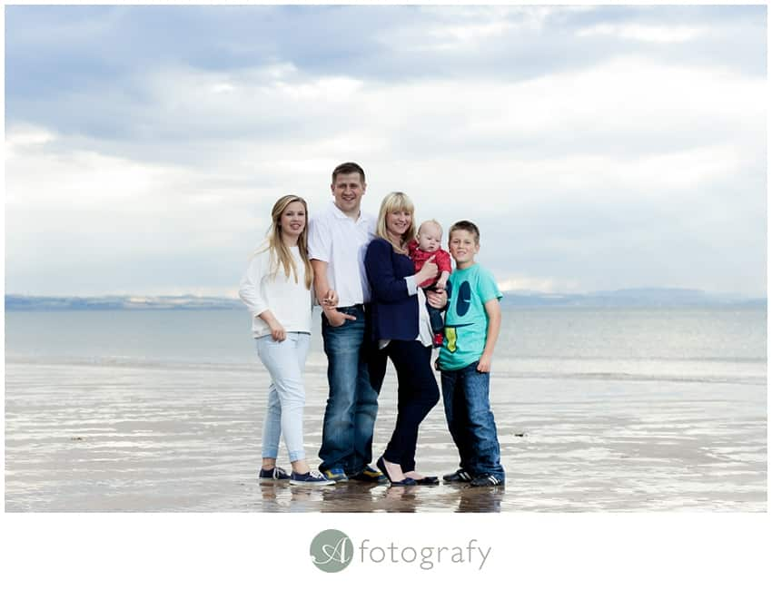 Family with children in East Lothian Gullane beach during the photoshoot.