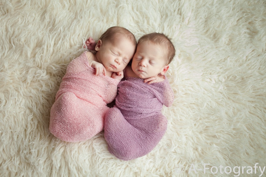 Newborn twins baby photos in cheesecloth wrap
