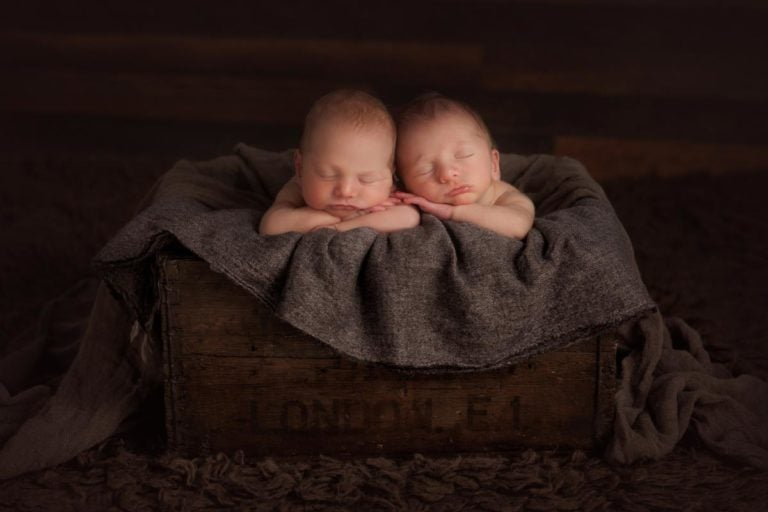 newborn twins in the box for frontal hands under the chin pose