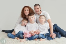 Newborn and sibling photos with family. 1