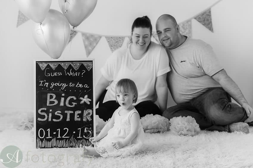 sibling pregnancy announcement photo