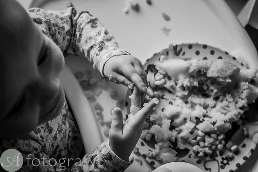 child fingers covered in food during photo session