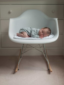Newborn photos at home. baby on the chair