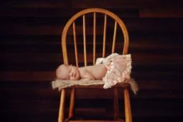 Newborn baby photos in tutu on chair