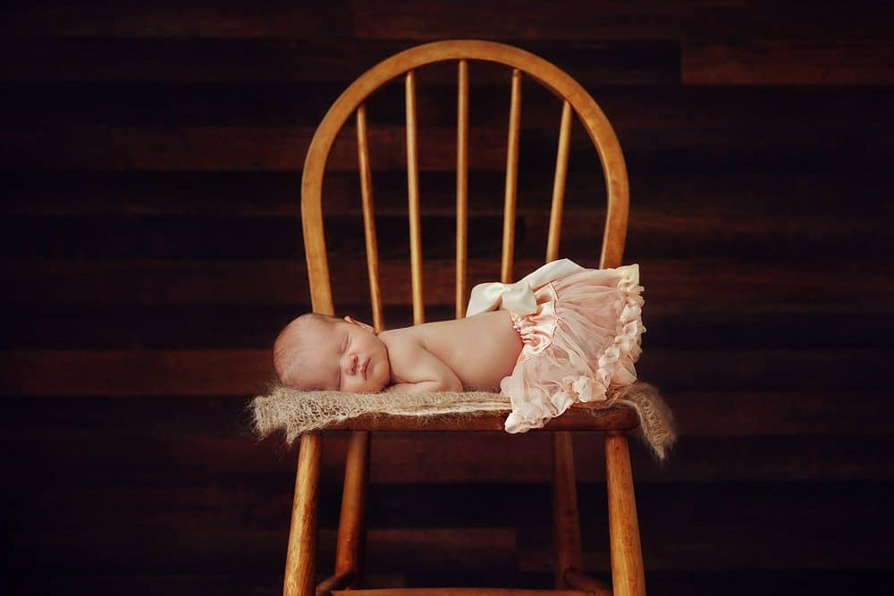 Newborn baby photos in tutu on chair