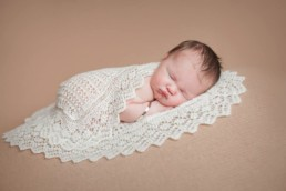 Newborn baby wrapped in heirloom blanket passed onto generations