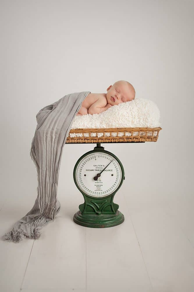 artistic newborn portrait on scale unique picture ideas