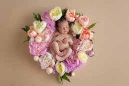 Newborn posed in floral crown for creative photography ideas