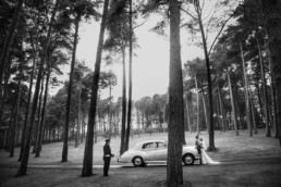 wedding couple standing in the archerfield house wedding venue forest