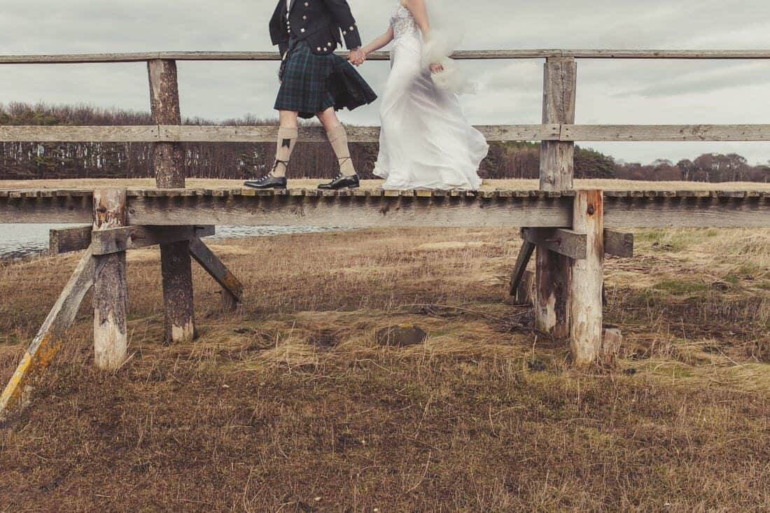 wedding photography ideas with wedding couple on bridges