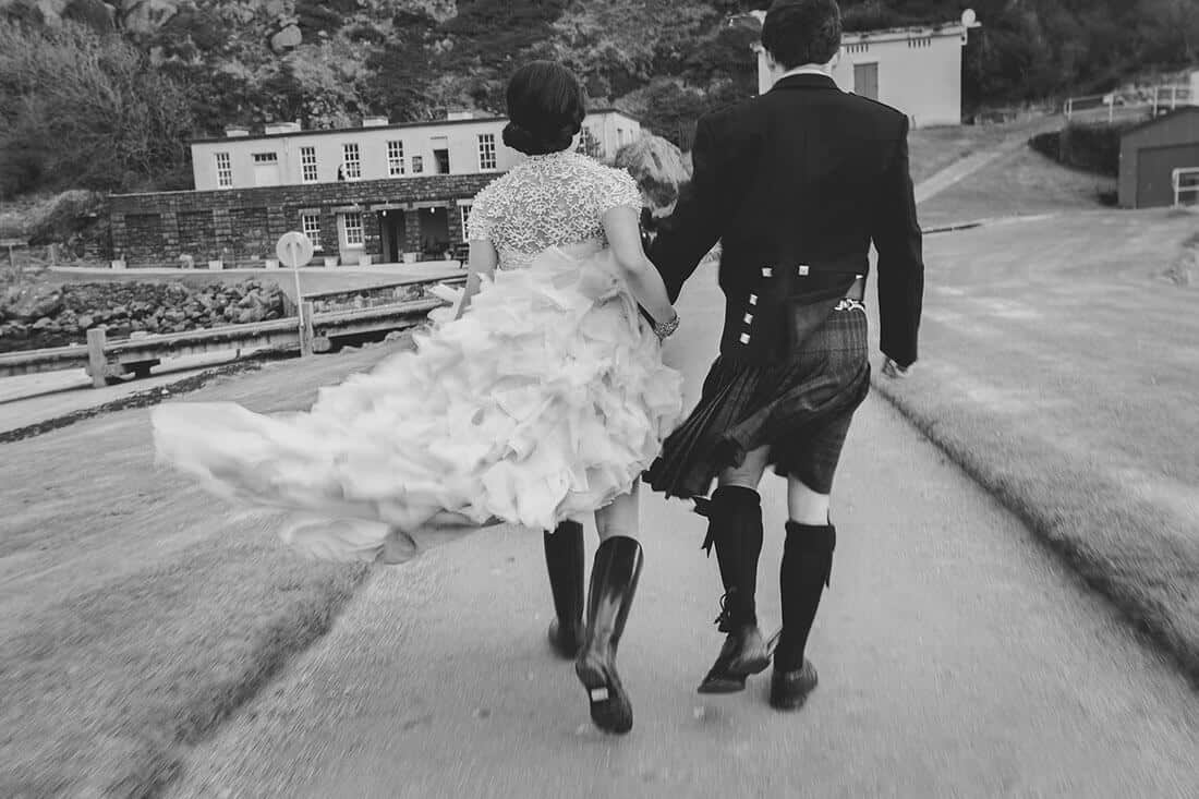 wedding dress flying in the wind on inchcolm island edinburgh