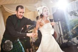 crazy wedding dancing with wedding couple