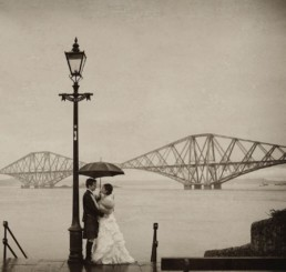 edinburgh south queensferry with wedding couple in the rain