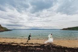 creative wedding photography with running couple in Edinburgh