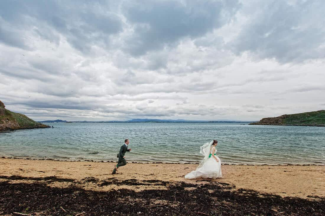 creative wedding photography with running couple in Edinburgh