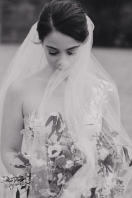 beautiful wedding bride portrait with veil in wind