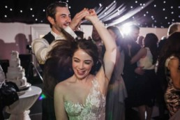 wedding couple is having fun dancing at archerfield house