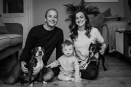family posing for a photographer in Edinburgh