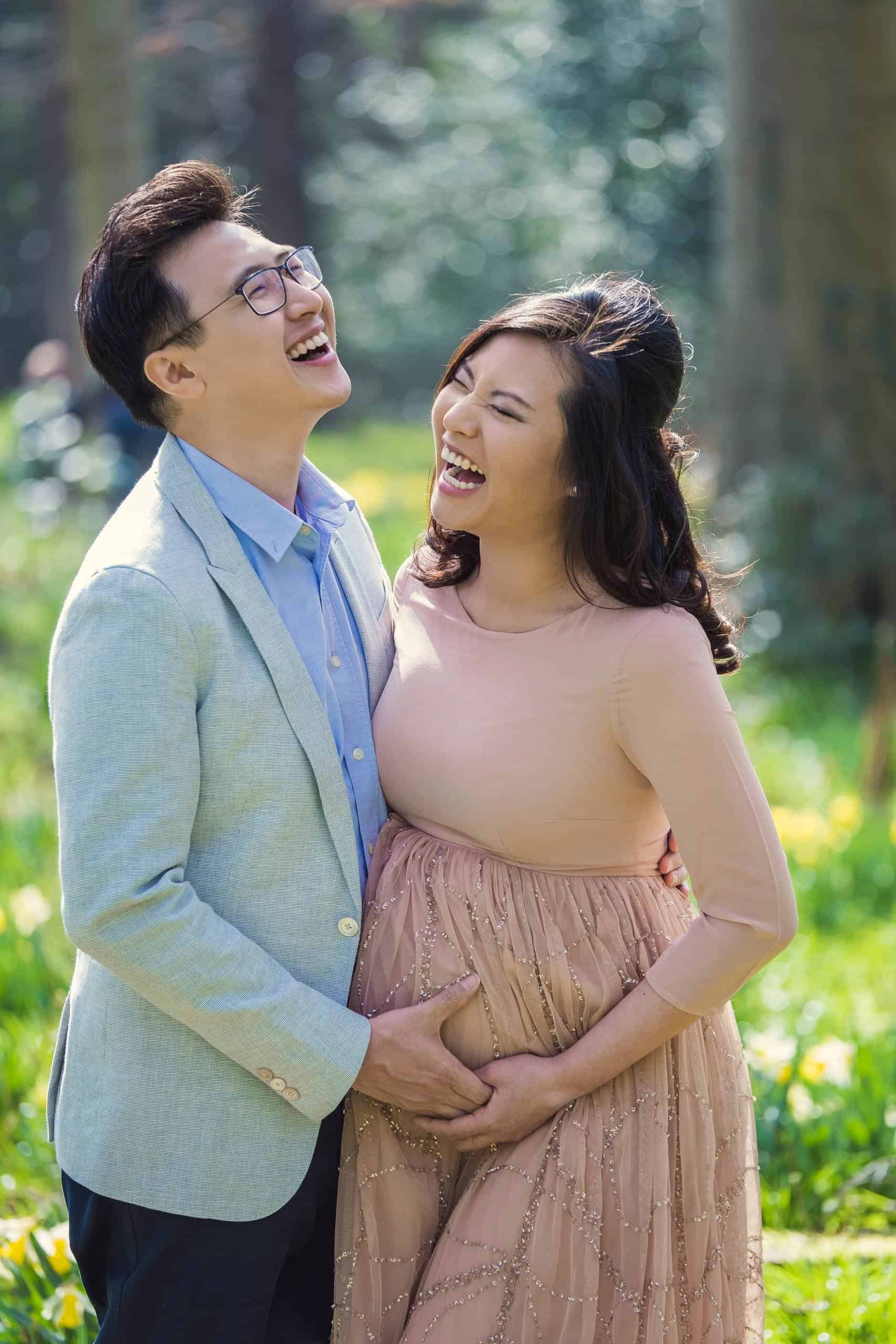 fun maternity photo with a couple