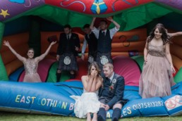 wedding bouncy castle with bride and groom