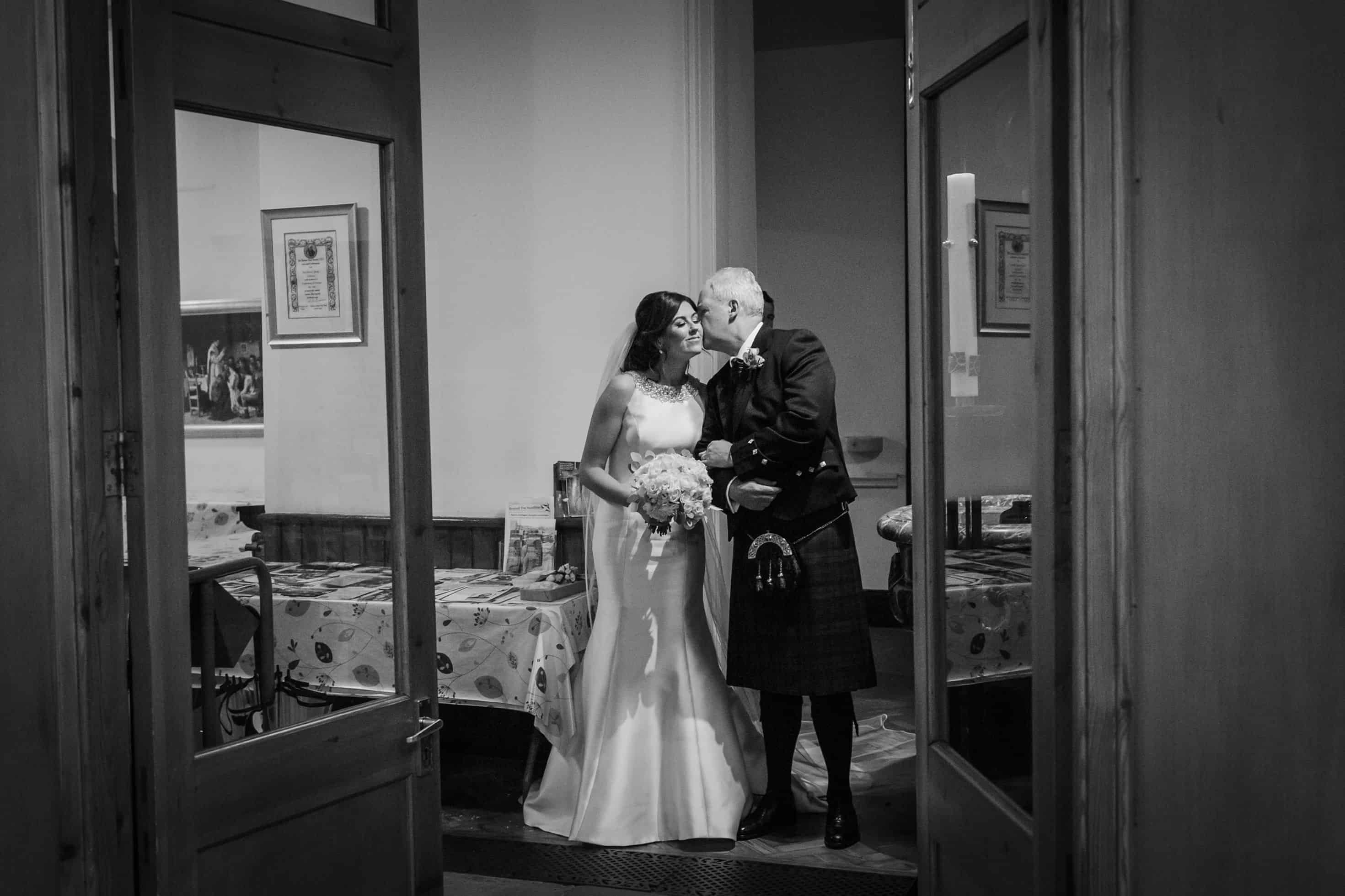 candid wedding moment with bride and her dad before they walk the isle