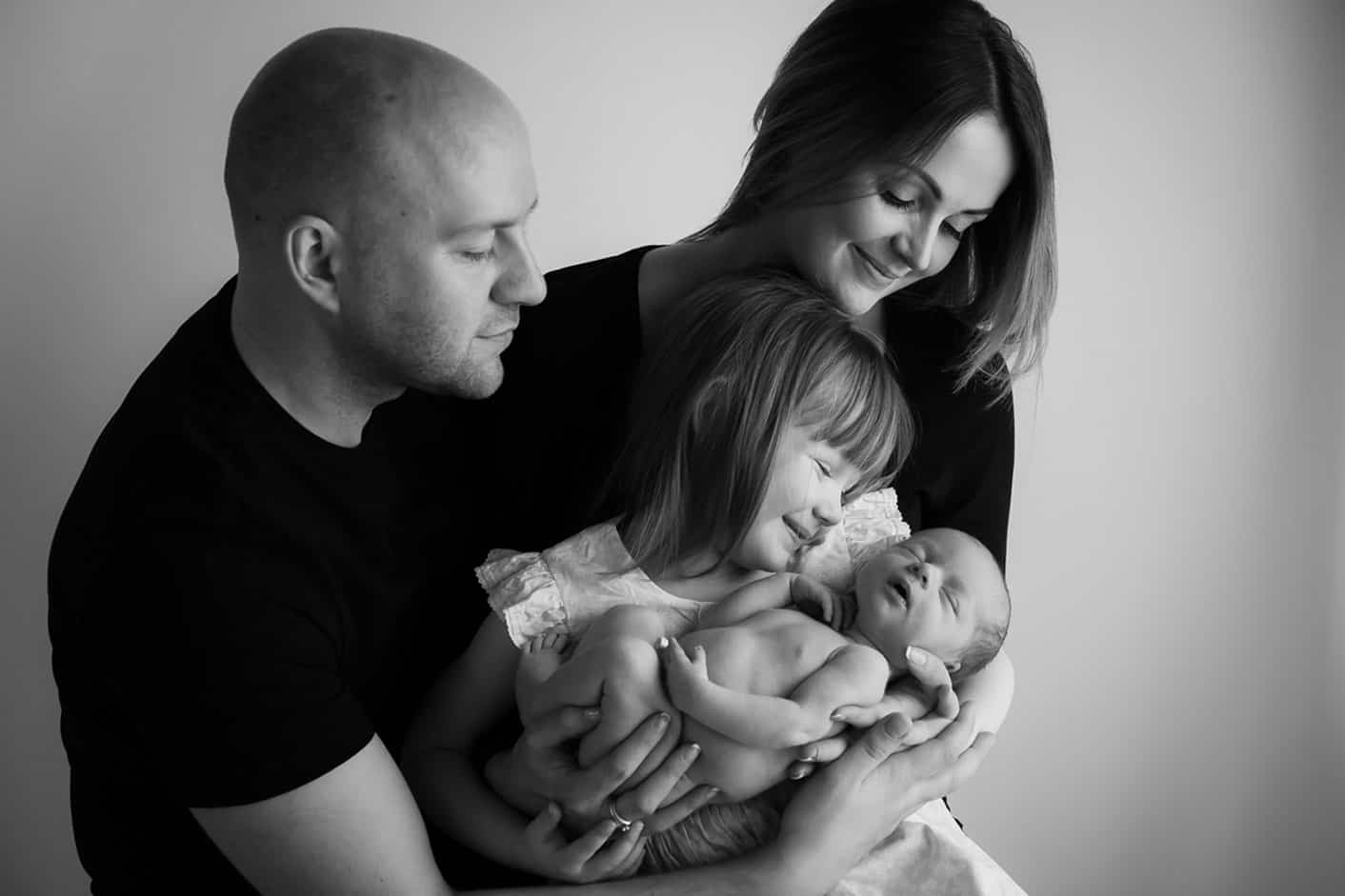 Newborn family photo with sibling
