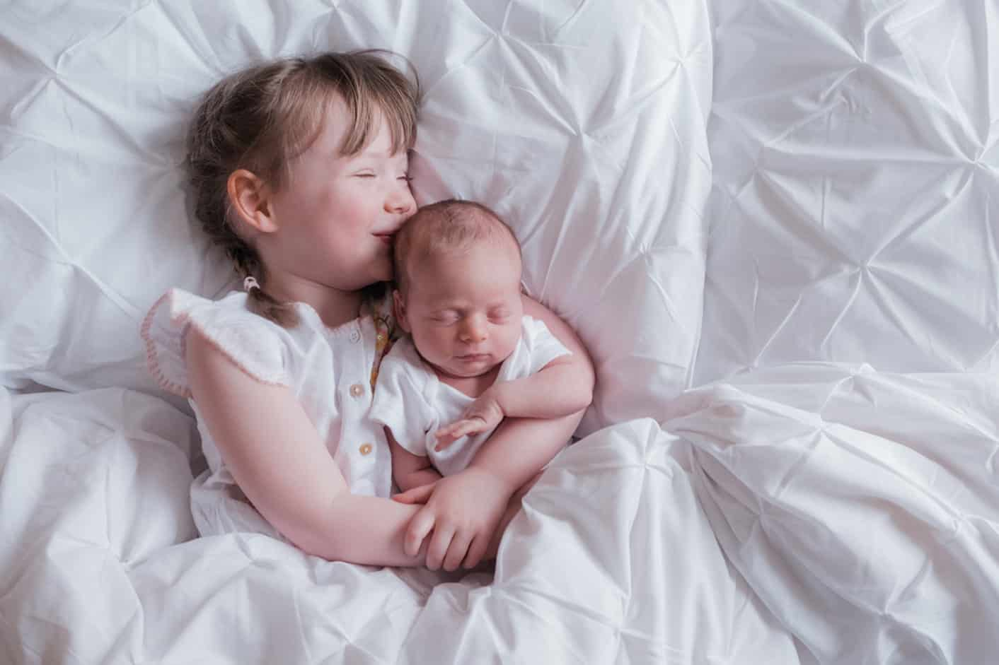 newborn photos with siblings at home