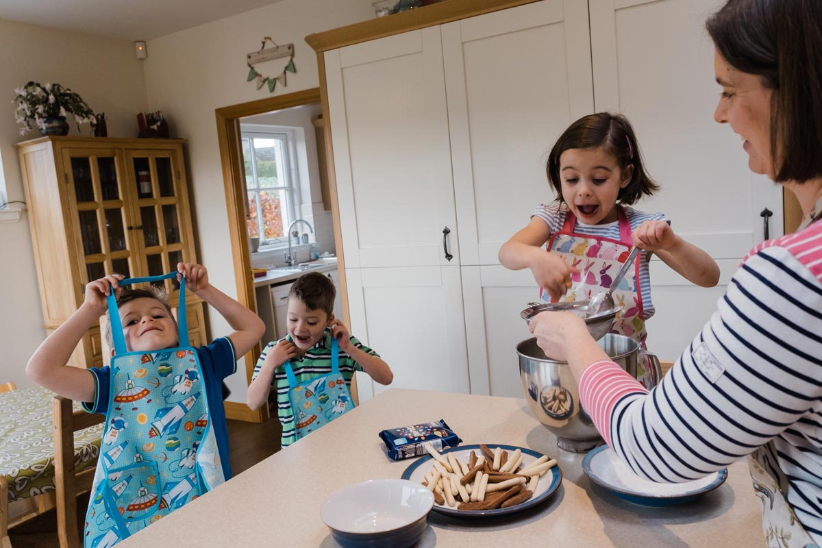 Family baking during natural family portrait session