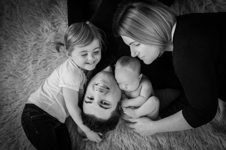 Newborn family photos with siblings and dogs. 7
