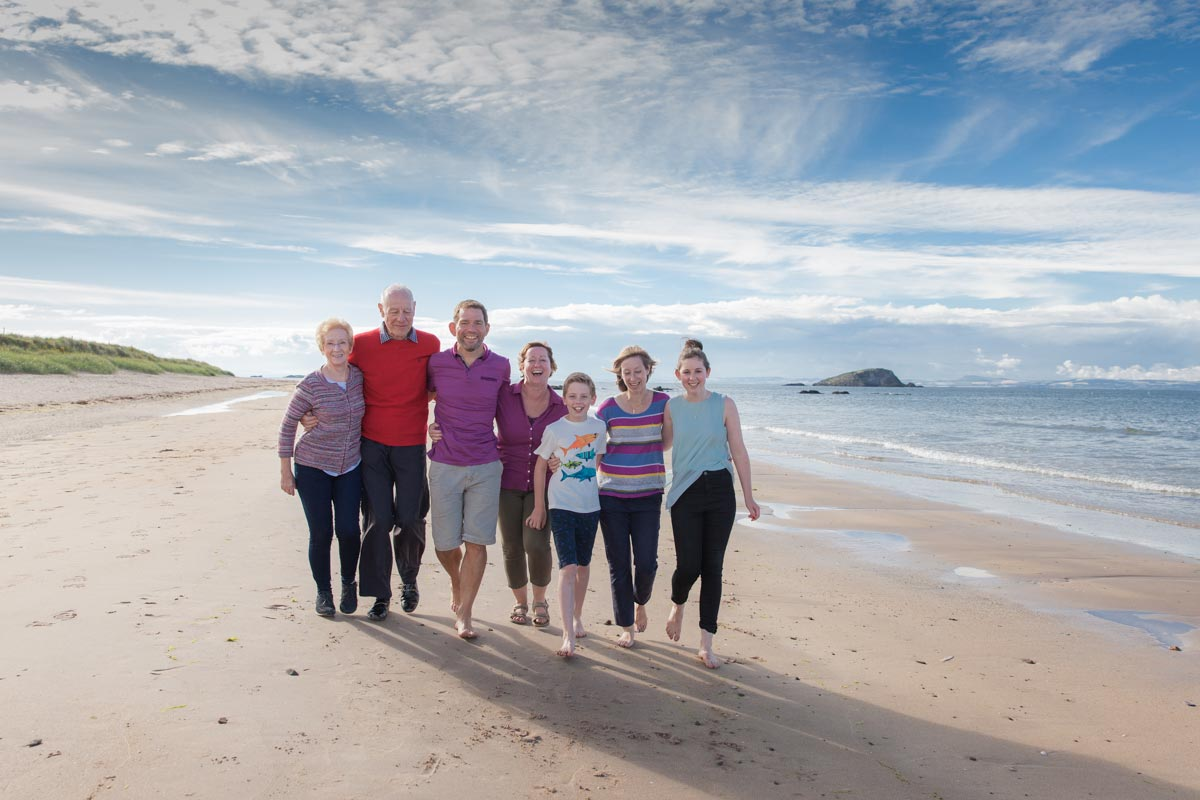 Family walking on the beach in North Berwick