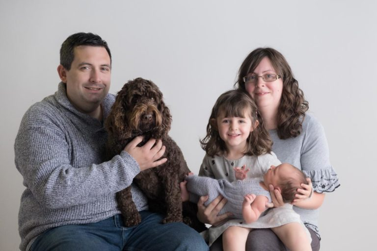 Newborn family photos with siblings and dogs. 21