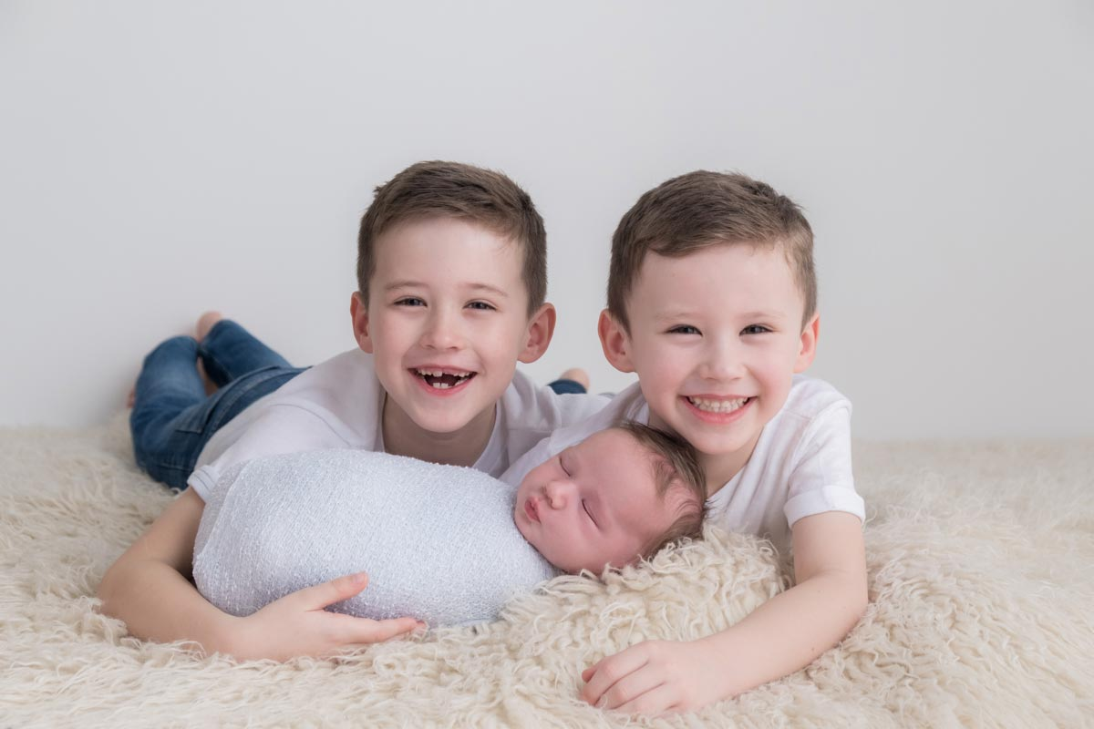 Newborn with siblings photos